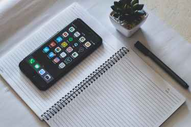 space grey apple iphone on notebook page